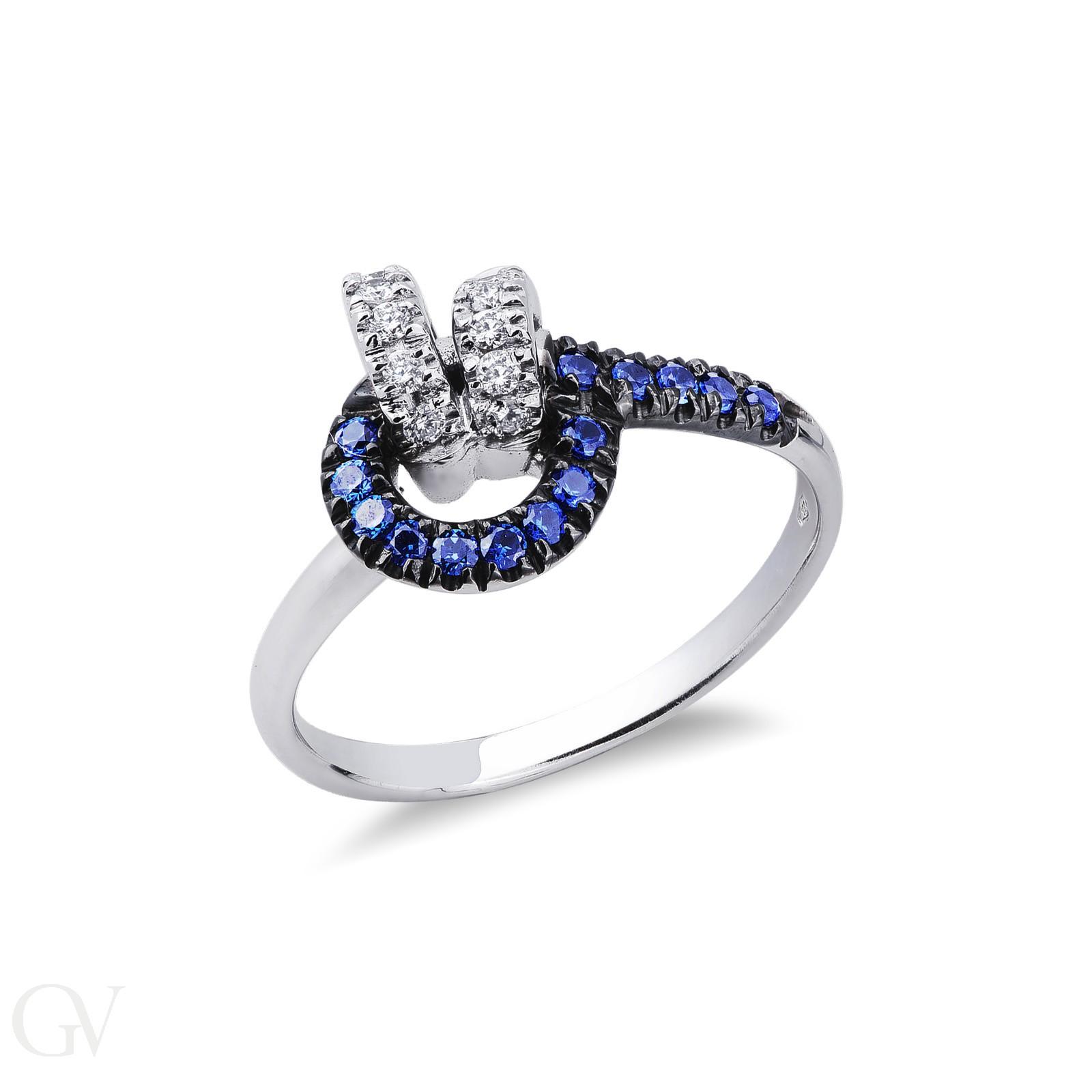 Anello in Oro bianco 18k con nodo in Diamanti a Zaffiri Blu