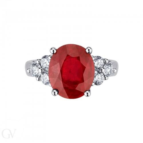 Anello in oro bianco 18k con rubino centrale e diamanti