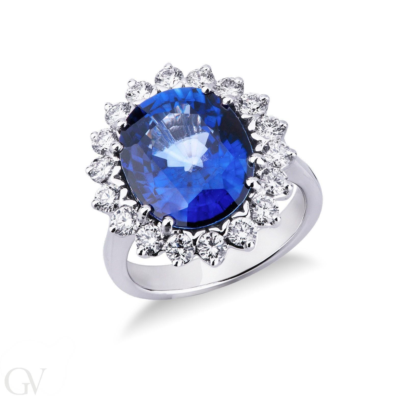 Anello contorno in oro bianco 18k con diamanti e Zaffiro Blu.