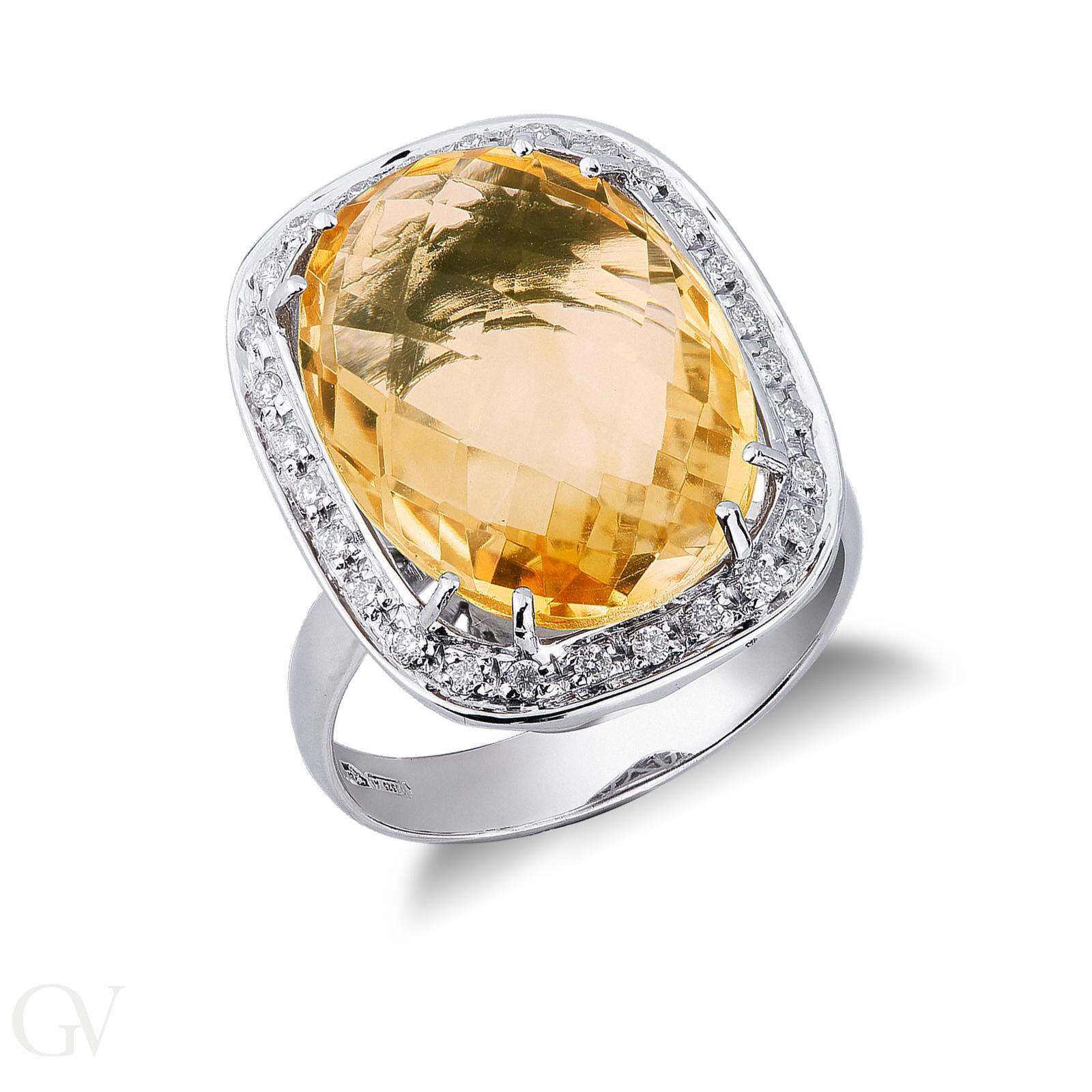 Anello contorno in oro bianco 18k con topazio citrino e diamanti.