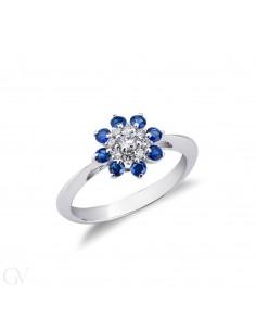 Anello in Oro Bianco 18k con contorno in Zaffiri blu e Diamanti