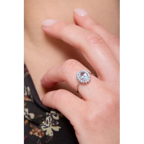 Anello contorno in oro bianco 18k con acquamarina e diamanti