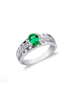 Anello in oro bianco 18k in smeraldo centrale e diamanti