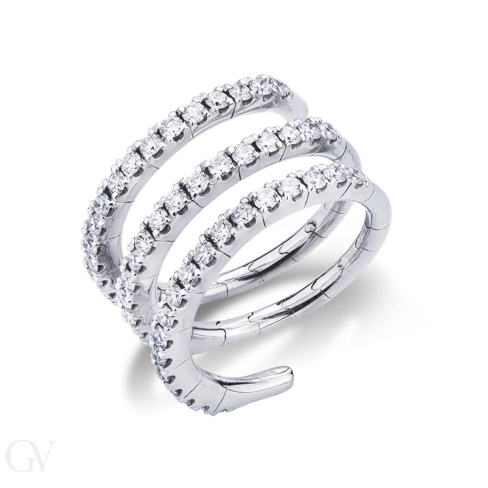 Anello elastico in oro bianco 18k con diamanti.