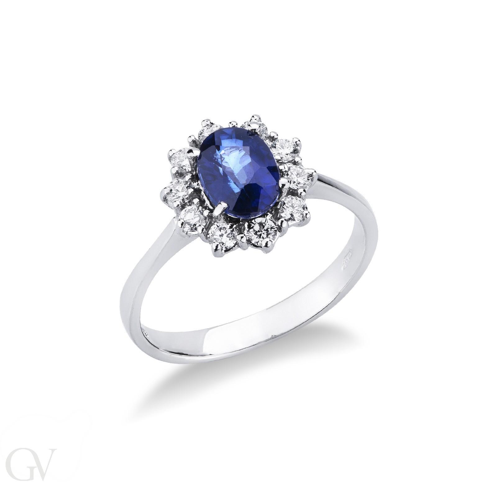 Anello contorno in oro bianco 18k con Zaffiro blu e Diamanti.