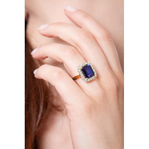 Anello contorno in oro giallo 18k con diamanti e Zaffiro Blu