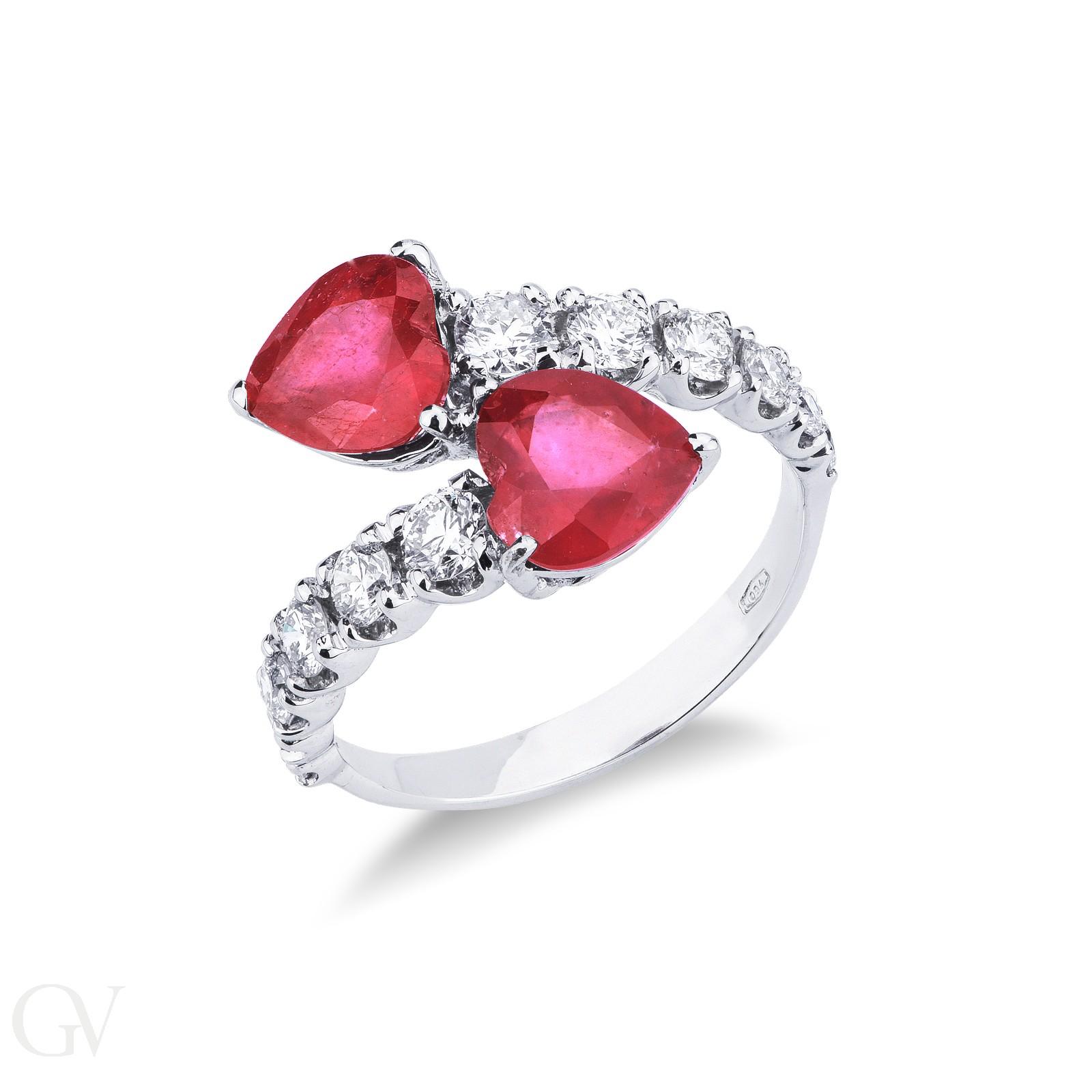 Anello contrarie\' con diamanti a scalare e 2 rubini cuore.